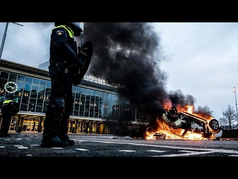 Dutch police clash with anti-curfew protesters, amid looting and vandalism